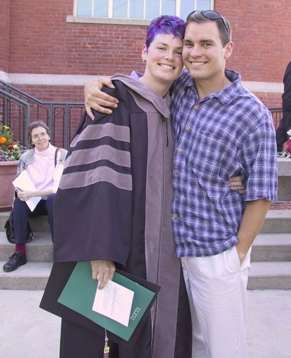 This is me and my husband, Gary, at my vet school graduation in 2001. My mom, Ann, is on the steps. And, yes, I really did dye my hair purple and blue for the occasion!